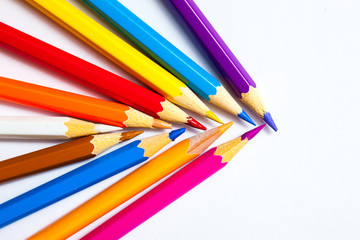 set of colored pencils on white background