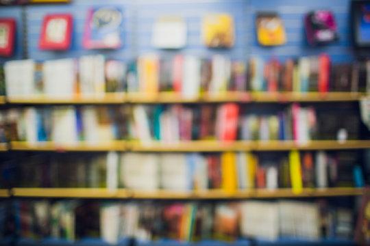 Comic books in bookshelf for background store.