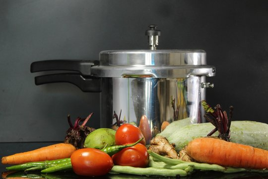 Vegetables placed near the pressure cooker