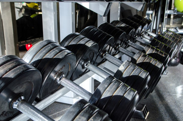 many dumbbells, dumbbells in the gym
