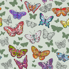 Seamless pattern with colorful ornate flying butterflies.