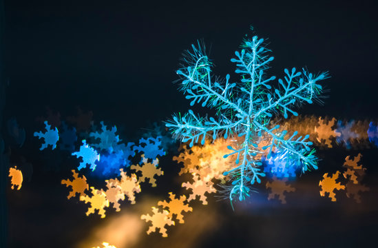 snowflake on colorful bokeh background, snowflake with blurred background.