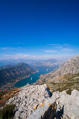 Beautiful landscape view of Bay of Kotor in Montenegro with blue cloudy sky