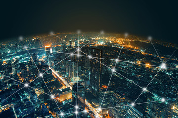Network and Connection technology night city background at business center bangkok thailand. Wireless skyline connection with energy light infographic. Wall mural