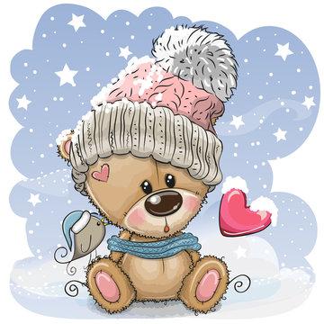 Cartoon Teddy bear in a knitted cap sits on a snow
