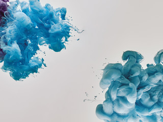 Wall Mural - blue splashes of paint on white background
