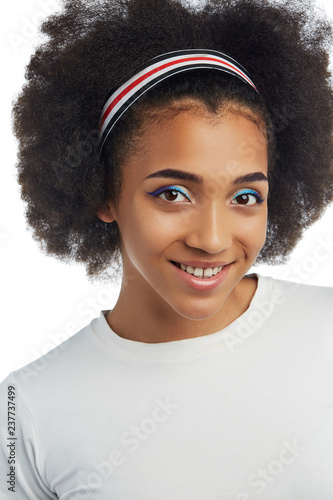 Closeup Portrait Of A Smiling African Lady With Short Curly