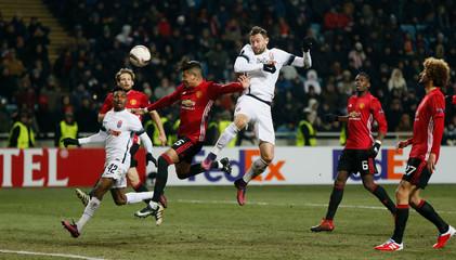 FC Zorya Luhansk's Zeljko Ljubenovic with a header at goal