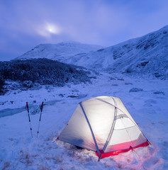Camp tent in winter mountains at the night