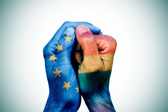 hands patterned with european and rainbow flags