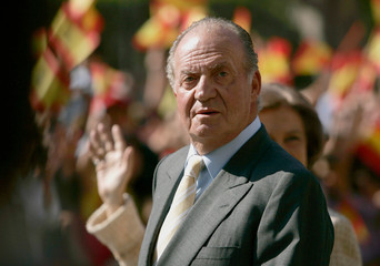 Spain's King Juan Carlos and Queen Sofia attend a welcome ceremony in the Spanish enclave of Melilla