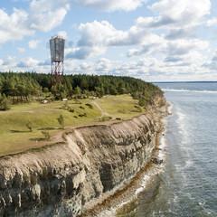 Panga coastal cliff and lighthouse (Panga pank), Saaremaa island, near Kuressaare, Estonia. North-Estonian limestone escarpment, Baltic Klint.