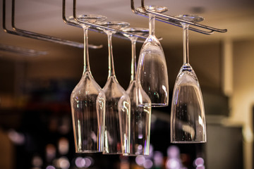 Picture of champagne glass on the rack in the cafe