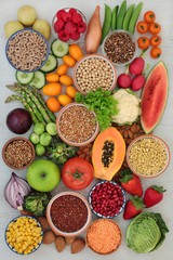 Alkaline health food concept for ph balance with grain, vegetables, fruit, medicinal herbs, spice, nuts and whole wheat pasta. High in omega 3, antioxidants, anthocyanins, fibre & vitamins. Top view.