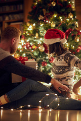 Young couple in love at Christmas night.