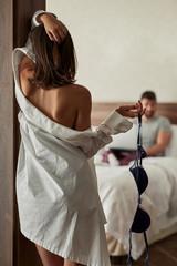 Seducing - Romantic moment in the bedroom .