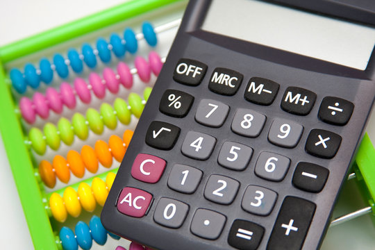 Calculator and a colorful abacus