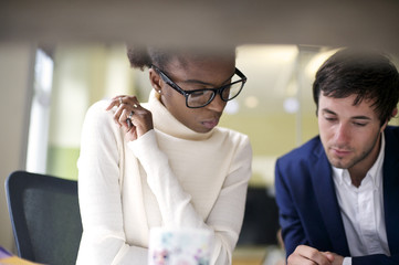 Black businesswoman with white male colleague