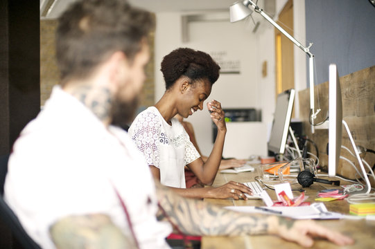 Black woman in an informal creative studio