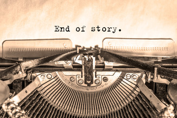 end of story printed on a piece of paper on a vintage typewriter. writer, journalist.