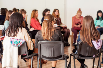 Group of young women talking sitting in a circle. Psychological support