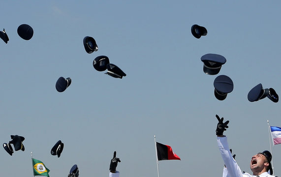 Air force officers throw their caps in air during graduation at AFA in Pirassununga