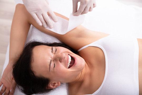 Woman Going Through Armpit Hair Removal Procedure