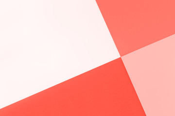 Trend photography on the theme of the actual colors for this season - a shade of orange.  Abstract geometric bright colored paper background.