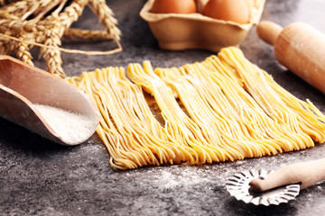 pasta. Fresh homemade pasta with pasta ingredients on the rustic table.