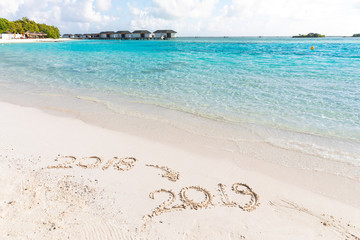 2019 writing on the sand, new year sign