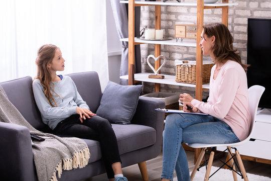 Girl Explaining Her Problems To Psychiatrist