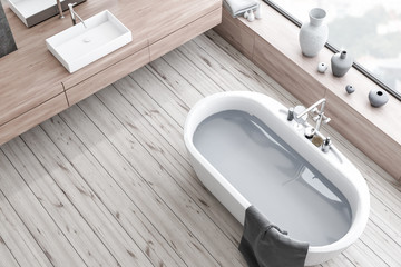 Top view of wooden floor bathroom, tub and sink