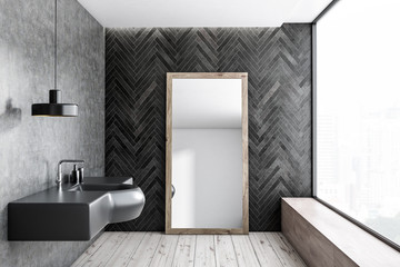 Black wood and concrete bathroom, sink and mirror