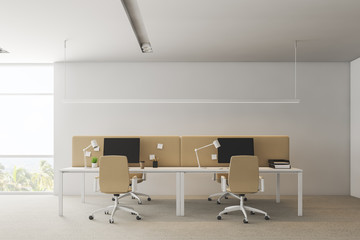 White office interior with beige tables