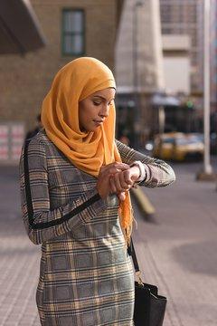 Woman using smart watch in city