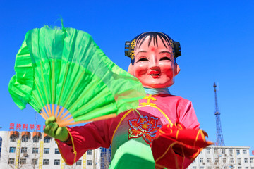 Chinese traditional style yangko folk dance girl mask in the street, luannan County, hebei Province, China