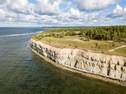 Panga coastal cliff (Panga pank, Mustjala cliff), northern shore of Saaremaa island, near Kuressaare, Estonia. North-Estonian limestone escarpment, Baltic Klint. Bird eye aerial drone photography.