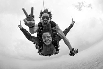 Skydiving tandem happiness black and white