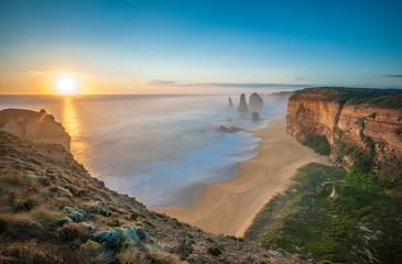 The 12 Apostles at sunset, near Port Campbell, Shipwreck Coast, Great Ocean Road, Victoria, Australia.