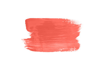 Living coral color abstract brush stroke isolated on white.