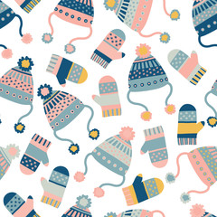 Seamless vector background with hats and mittens. Pattern tile with knitted winter clothes in pink and blue. Winter wear design, flat Scandinavian style. Use for paper, banner, cards, poster, fabric.