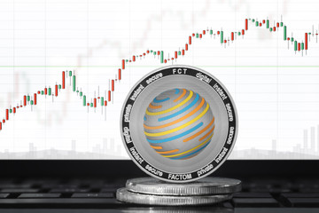Factom (FCT) cryptocurrency; Factom coin on the background of the chart