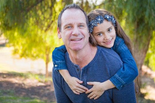 Cute Young Mixed Race Girl And Caucasian Grandfather Having Fun Outdoors