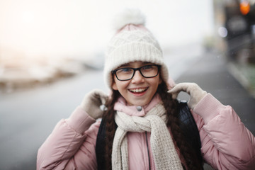 Close up portrait of young teen girl smiling outdoor.