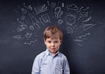 Smart little kid in front of a drawn up blackboard ruminate