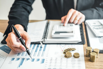 Business man Accounting Calculating Cost Economic budget investment and saving concept