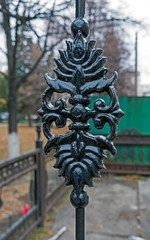 cast iron detail of city fence grating