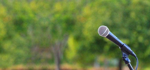 microphone standing for speaker on the outdoor natural setting for music, concert and environmental...