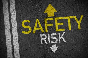 Asphalt with arrows forward safety and back risk