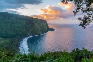 Waipio Valley sunset over the ocean